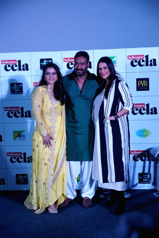 "Actors Kajol, Ajay Devgn and Neha Dhupia at the trailer launch of upcoming film ""Helicopter Eela"" in Mumbai, on Aug 5, 2018. - Kajol, Ajay Devgn and Neha Dhupia"