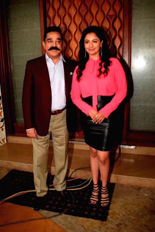 "Actors Kamal Haasan and Pooja Kumar during the promotion of their upcoming film  ""Vishwaroopam 2"" in Mumbai on July 31, 2018. - Kamal Haasan and Pooja Kumar"