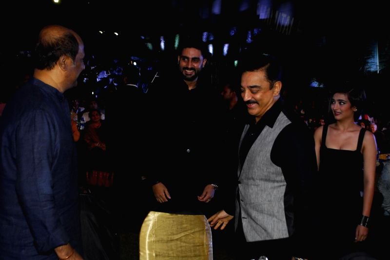 Actors Kamal Haasan, Rajnikanth and Abhishek Bachchan during the trailer launch of upcoming film Shamitabh and celebration of 1000 film of music composer Ilaiyaraaja in Mumbai on 20th Jan 2015. - Kamal Haasan, Rajnikanth and Abhishek Bachchan