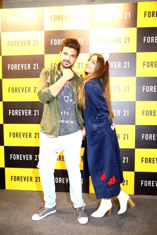 Actors Karan Kundra and Anusha Dandekar during a launch of clothing brand in Amritsar. - Karan Kundra and Anusha Dandekar