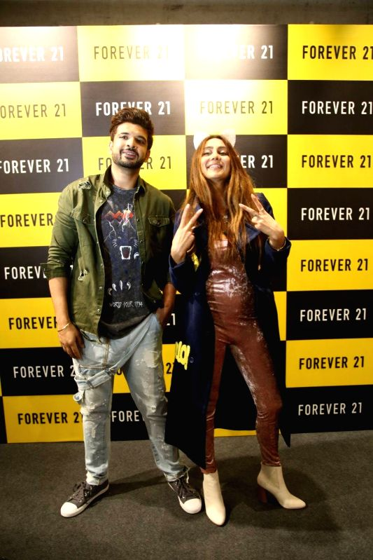 Actors Karan Kundra and Anusha Dandekar during a launch of clothing brand in Amritsar. - Karan Kundra and Anusha Dandekar
