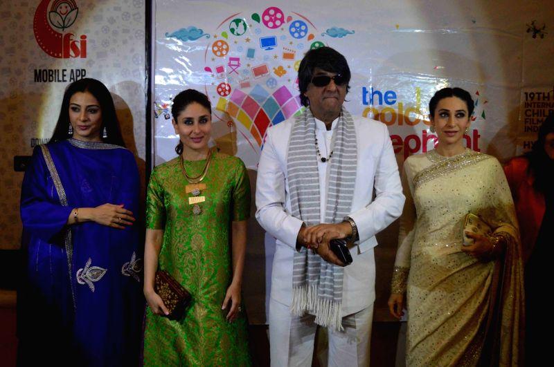 Actors Karishma Kapoor, Kareena Kapoor, Mukesh Khanna and Tabu during a programme in Hyderabad on Nov 14, 2015. - Karishma Kapoor, Mukesh Khanna and Tabu