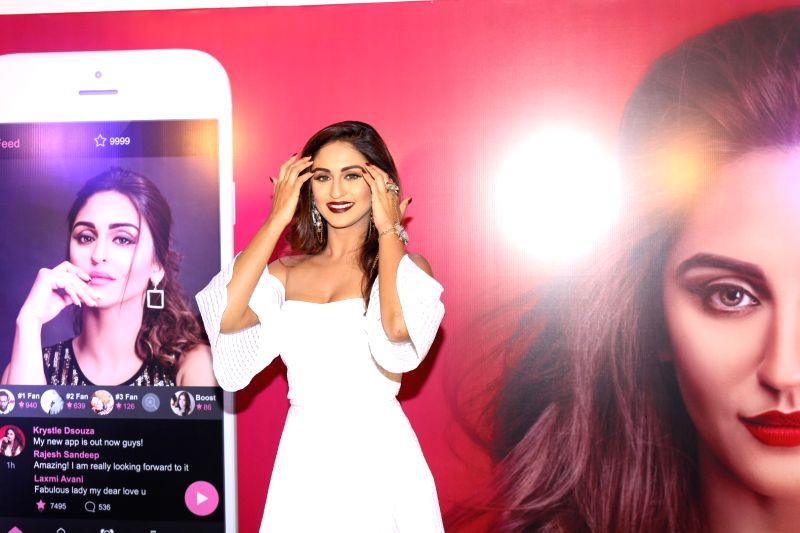 Actors Krystal D'souza during the launch of her own mobile application in Mumbai on April 20, 2017. - Krystal