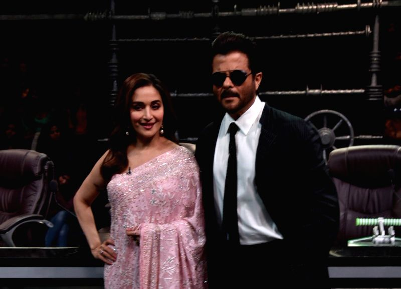"""Actors Madhuri Dixit and Anil Kapoor during the promotion of their upcoming film """"Total Dhamaal"""" on the sets of Super Dancer Chapter 3 in Mumbai on Feb. 10, 2019. Also seen her ... - Madhuri Dixit and Anil Kapoor"""