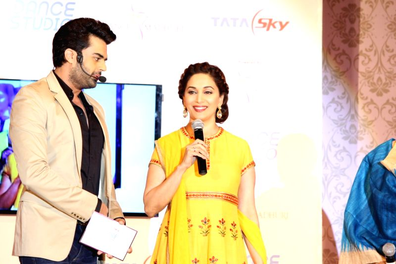 Actors Madhuri Dixit  and Manish Paul during the launch of Tata Sky's new interactive service 'Dance Studio' in association with RnM Moving Picture in Mumbai on  Dec 10,  2015 - Madhuri Dixit