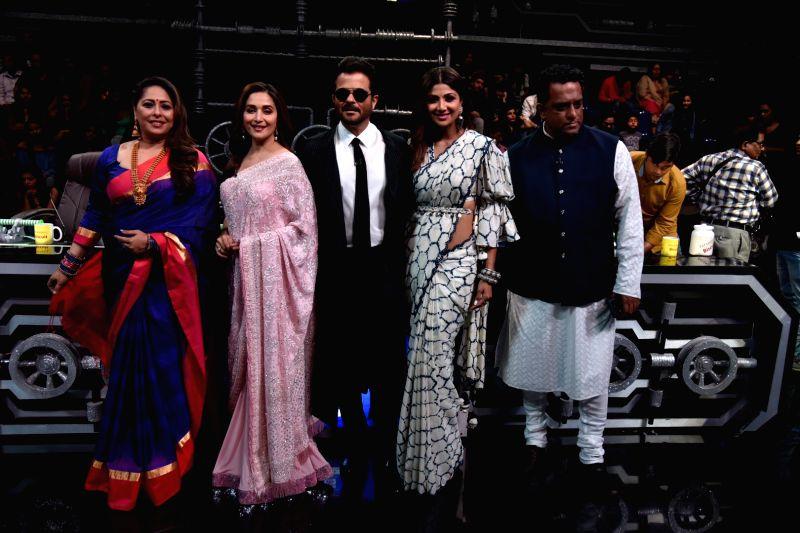 Actors Madhuri Dixit, Anil Kapoor, Shilpa Shetty Kundra, filmmaker Anurag Basu, and Geeta Kapoor on the sets of Super Dancer Chapter 3 in Mumbai on Feb. 10, 2019. Also seen her husband ... - Madhuri Dixit, Anil Kapoor, Shilpa Shetty Kundra, Anurag Basu and Geeta Kapoor