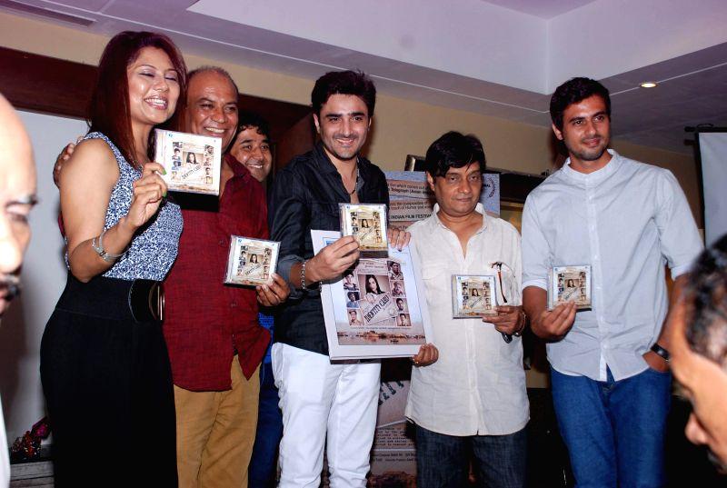 Actors Manini De, Vipin Sharma, Furqan Merchant, Brajesh Kala and Shoaib Kazmi during the music launch of film Identity Card in Mumbai, on Aug. 16, 2014. - Manini D and Vipin Sharma