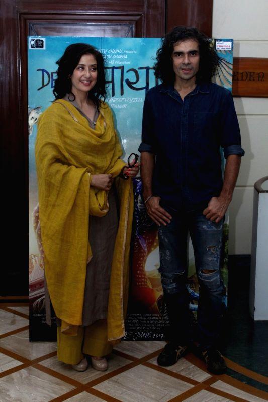 Actors Manisha Koirala and filmmaker Imtiaz Ali during the media interaction of film Dear Maya in Mumbai, on May 22, 2017. - Manisha Koirala
