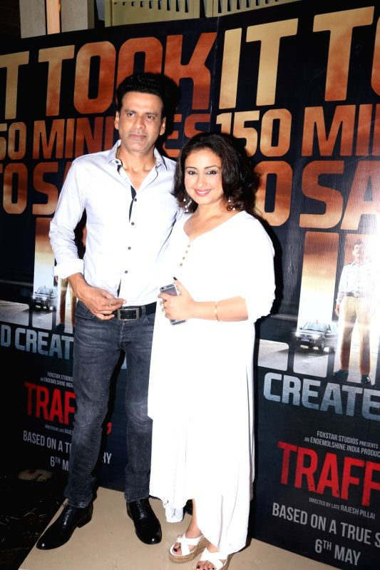 Actors Manoj Bajpayee and Divya Dutta during the screening of film Traffic in Mumbai on May 5, 2016. - Manoj Bajpayee and Divya Dutta