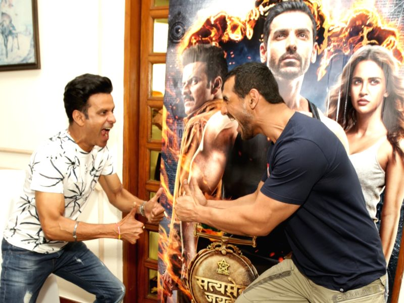 "Actors Manoj Bajpayee and John Abraham during the promotion of their upcoming film ""Satyameva Jayate"" in New Delhi on Aug 9, 2018. - Manoj Bajpayee and John Abraham"