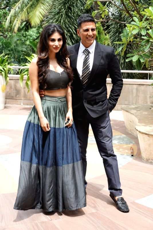 "Actors Mouni Roy and Akshay Kumar during the promotion of their upcoming film ""Gold"" in Mumbai on July 30, 2018. - Mouni Roy and Akshay Kumar"