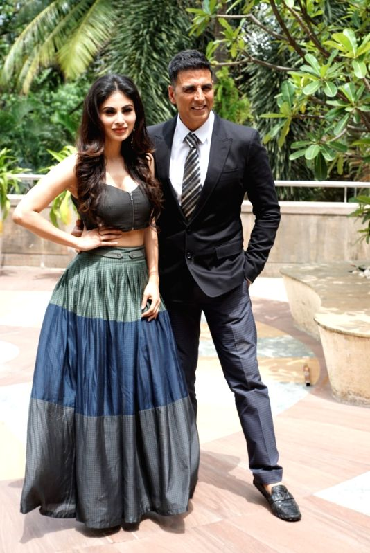 """Actors Mouni Roy and Akshay Kumar during the promotion of their upcoming film """"Gold"""" in Mumbai on July 30, 2018. - Mouni Roy and Akshay Kumar"""