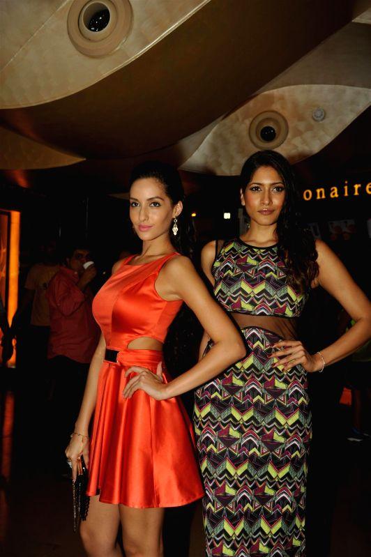 Actors Naura Fathi and Himarsha Venkatsamy during the first look of film Roar in Mumbai, on July 31, 2014. - Naura Fathi and Himarsha Venkatsamy
