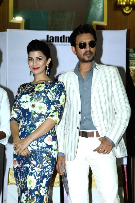 Actors Nimrat Kaur and Irrfan Khan during the DVD launch of film The Lunchbox in Mumbai on August 6, 2014. - Nimrat Kaur and Irrfan Khan