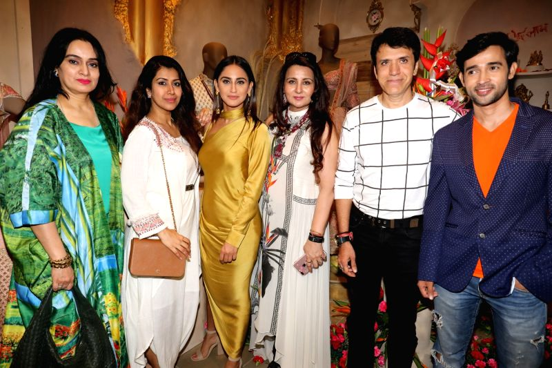 Actors Padmini kolhapure, Krystle Dsouza, Poonam Dhillon and Suraj Thapar at the launch of a designer store, in Mumbai on July 21, 2018. - Padmini