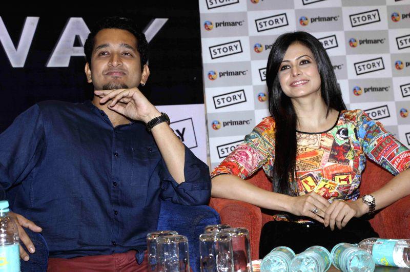 Actors Parambrata Chatterjee and Koel Mallick during a programme in Kolkata on July 28, 2014. - Parambrata Chatterjee and Koel Mallick