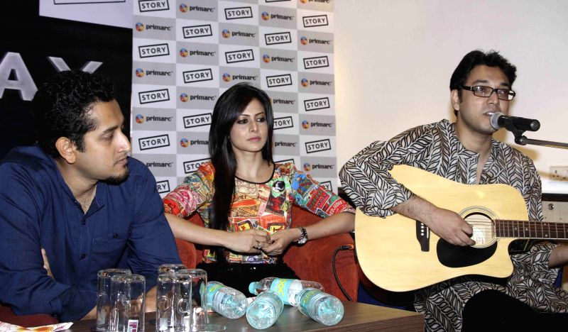 Actors Parambrata Chatterjee, Koel Mallick and singer Anupam Roy during a programme in Kolkata on July 28, 2014. - Parambrata Chatterjee, Koel Mallick and Anupam Roy