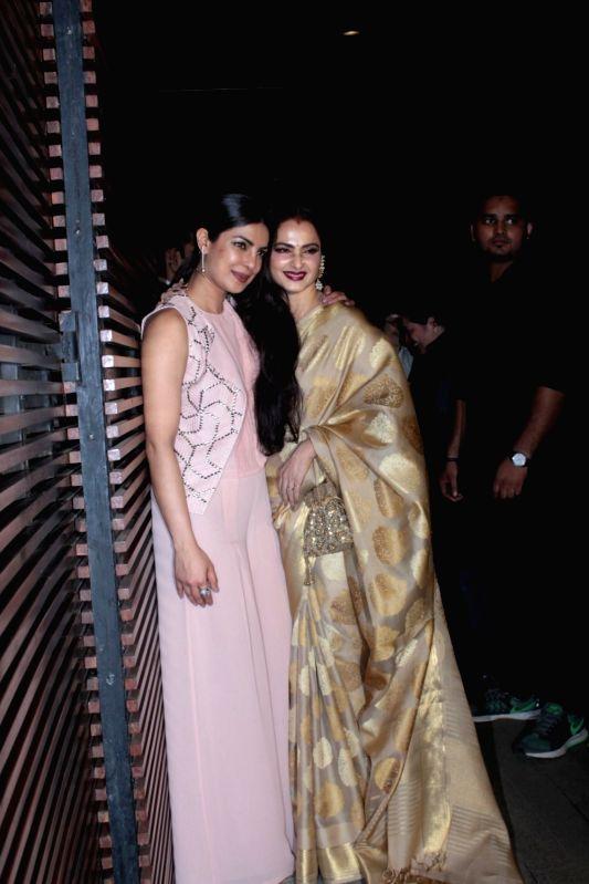 Actors Priyanka Chopra and Rehka during her party in Mumbai on April 26, 2017. - Priyanka Chopra and Rehka