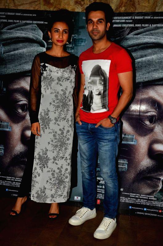 Actors Rajkummar Rao and Patralekha during the screening of the film Madaari in Mumbai on July 20, 2016. - Rajkummar Rao and Patralekha