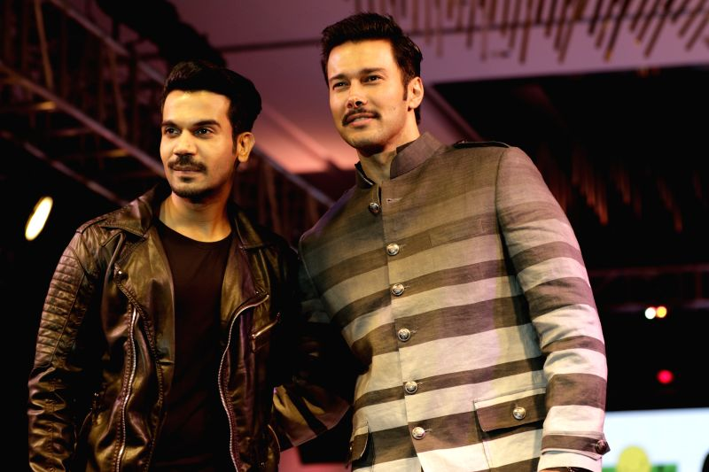 Actors Rajkummar Rao and Rajneesh Duggal walks the ramp during for 9th edition of charity fashion show organized by Smile Foundation in Mumbai, on August 2, 2015. - Rajkummar Rao and Rajneesh Duggal