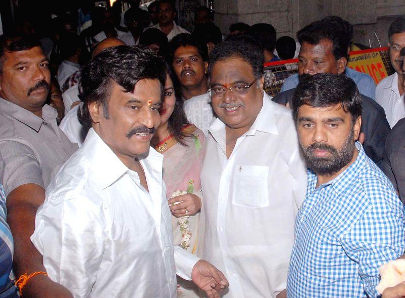 Actors Rajnikanth and Ambareesh arrive to attend the muhurat shot of film 'Lingaa' at Chamundi Hill in Mysore  on May 2, 2014. - Rajnikanth and Ambareesh
