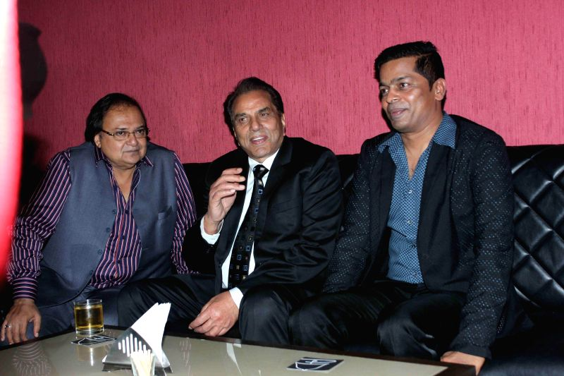 Actors Rakesh Bedi, Dharmendra with Shrikant Bhasi, Chairman of Carnival Group during the launch of Carnival Cinemas in Mumbai on July 10, 2014. - Rakesh Bedi and Dharmendra