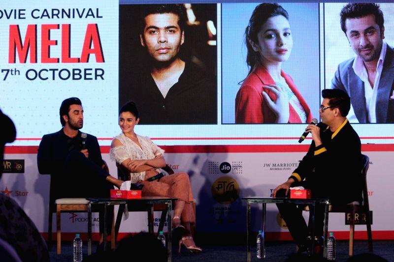 "Actors Ranbir Kapoor,Alia Bhatt and director Karan Johar at ""Jio Mami Film Mela"" in Mumbai on Oct 7, 2017. - Karan Johar and Ranbir Kapoor"