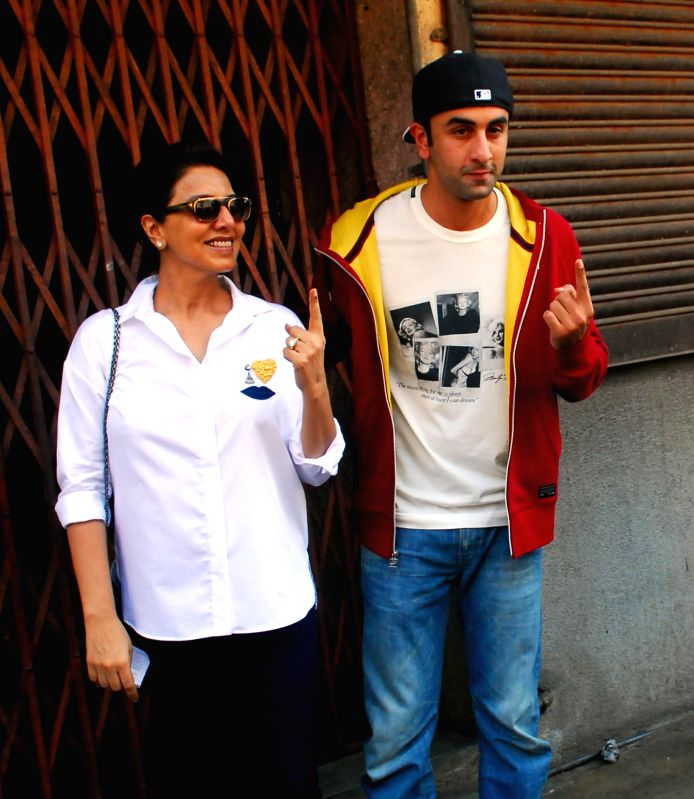 Actors Ranbir Kapoor and his mother Neetu Singh show their fore fingers marked with phosphorous ink after casting their votes at a polling booth during the sixth phase of 2014 Lok Sabha Polls in ...