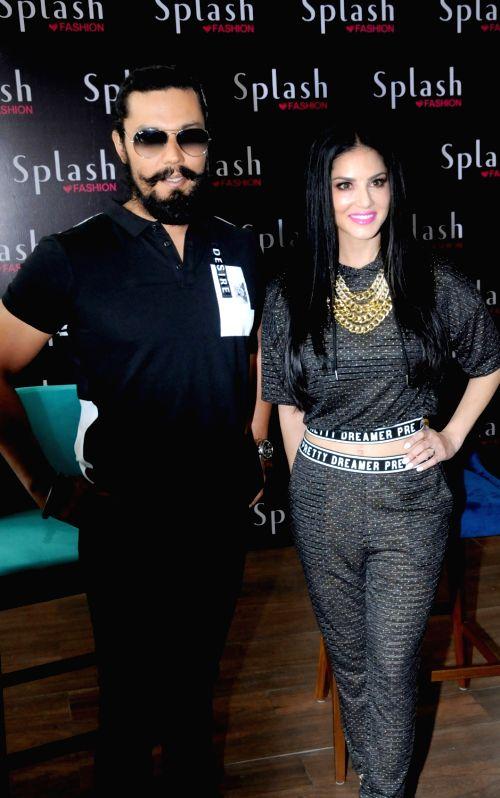 Actors Randeep Hooda and Sunny Leone during a programme in Amritsar on June 1, 2018. - Randeep Hooda and Sunny Leone