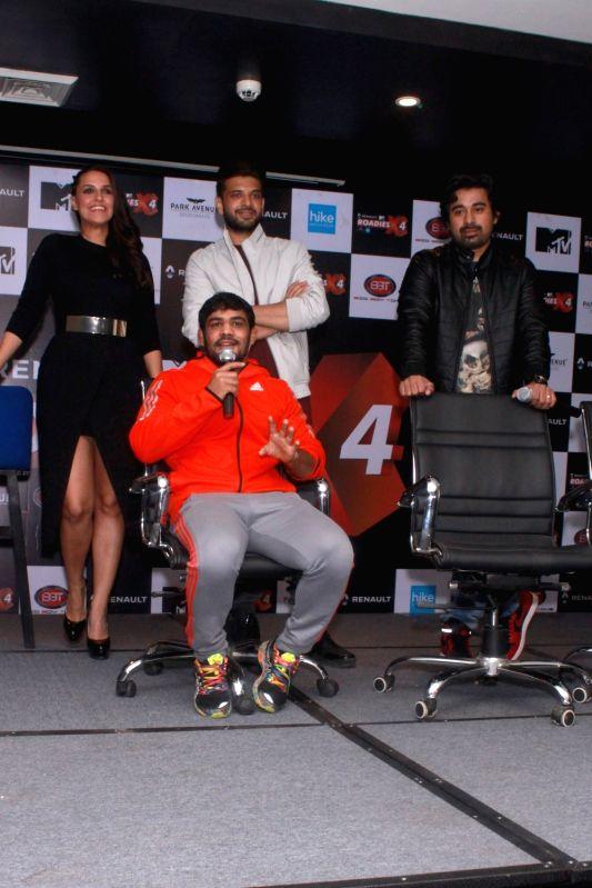 Actors Rannvijay Singh, Karan Kundra, Neha Dhupia and wrestler Sushil Kumar during a press meet of MTV Roadies X4, in New Delhi, on Nov 25, 2015. - Rannvijay Singh, Karan Kundra, Neha Dhupia and Sushil Kumar