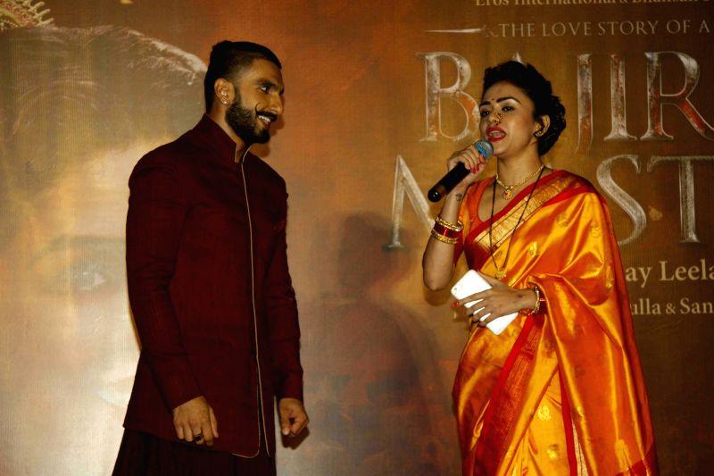 Actors Ranveer Singh and Amruta Khanvilkar during the promotion of her upcoming film Bajirao Mastani in Mumbai on Nov 28, 2015. - Ranveer Singh and Amruta Khanvilkar
