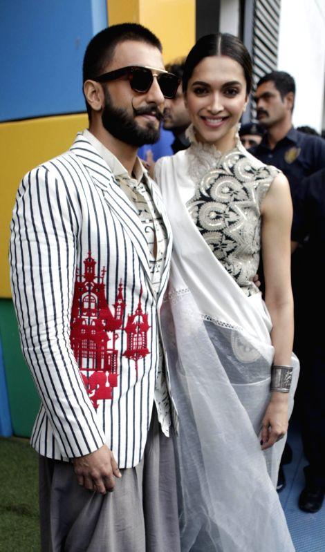 "Actors Ranveer Singh and Deepika Padukone during a programme organised to promote their upcoming film ""Bajirao Mastani"" in Ahmedabad, on Dec 10, 2015. - Ranveer Singh and Deepika Padukone"