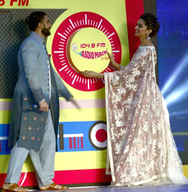"Actors Ranveer Singh and Deepika Padukone during a programme organised to promote their upcoming film ""Bajirao Mastani"" in Ahmedabad, on Dec 12, 2015. - Ranveer Singh and Deepika Padukone"