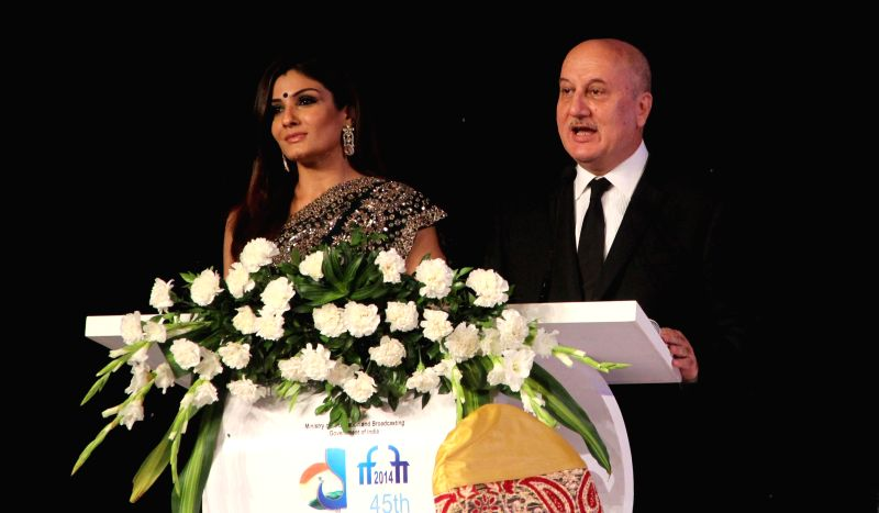 Actors Raveena Tandon and Anupam Kher at the inauguration of the 45th International Film Festival of India (IFFI-2014), in Panaji, Goa on Nov. 20, 2014. - Raveena Tandon and Anupam Kher