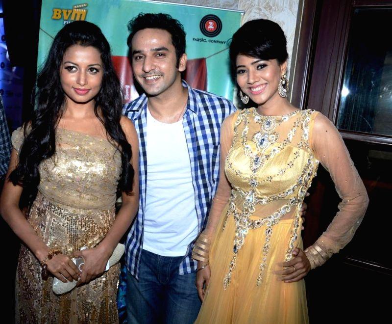 Actors Reecha Sinha, Puru Chibber, Rashee during the music launch of film Mainu Ek Ladki Chahiye in Mumbai on Aug 11, 2014. - Reecha Sinha, Puru Chibber and Rashee