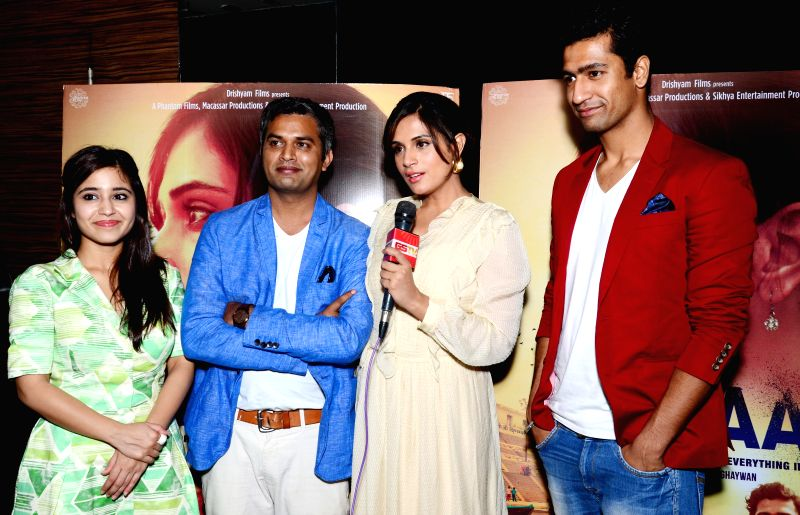 Actors Richa Chadda, Shweta Tripathi and Vicky Kaushal along with director Neeraj Ghaywan during a press conference to promote their upcoming film `Massan` in Ahmedabad on July 17, 2015. - Richa Chadda, Shweta Tripathi and Vicky Kaushal