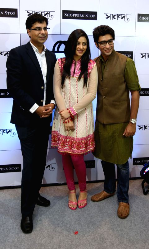 Actors Ridhima Ghosh and Gaurav Chakrabarty with Customer Care Associate & Executive Vice President of Shopper Stop Ltd, Vinay Bhatia during a programme in Kolkata on Sept 4, 2014.