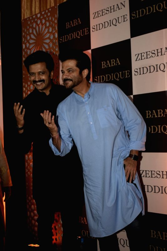 Actors Riteish Deshmukh and Anil Kapoor at politician Baba Siddique's iftar party in Mumbai on June 10, 2018. - Riteish Deshmukh and Anil Kapoor