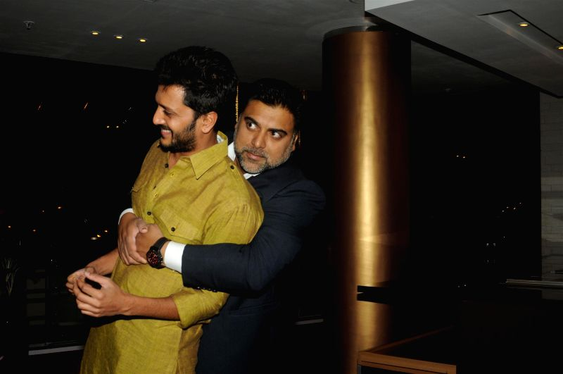 Actors Riteish Deshmukh and Ram Kapoor during the success party of film Humshakals organised by Fox Star Studios and filmmaker Vashu Bhagnani in Mumbai on June 24, 2014. - Riteish Deshmukh and Ram Kapoor
