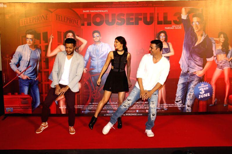 Actors Riteish Deshmukh, Jacqueline Fernandez and Akshay Kumar during the song launch of Taang Uthake from upcoming film Housefull 3, in Mumbai, on May 6, 2016. - Riteish Deshmukh, Jacqueline Fernandez and Akshay Kumar