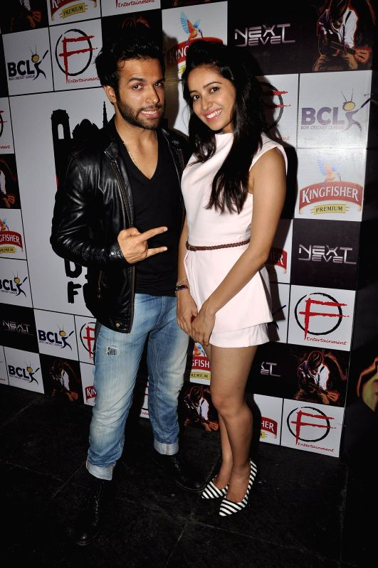 Actors Rithvik Dhanjani and Asha Negi  during the success party of Dilli Fukrey cricket team from Box cricket league (BCL) in Mumbai on April 26, 2014. - Rithvik Dhanjani and Asha Negi