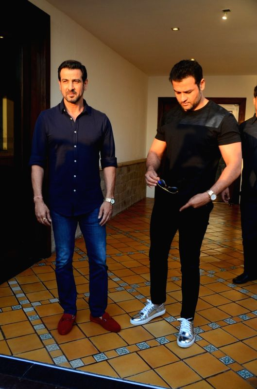 Actors Ronit Roy and Rohit Roy during the meet and greet with fans for the film Kaabil in Mumbai on April 11, 2017. - Ronit Roy and Rohit Roy