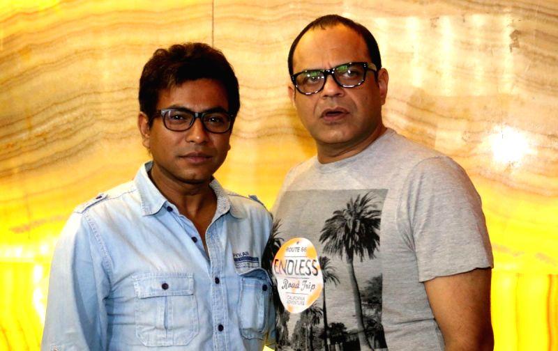 Actors Rudranil Ghosh (L) and Rajatava Dutta (R) during premiere of Bengali film 'MAYA' in Kolkata on July 11, 2014. - Rudranil Ghosh