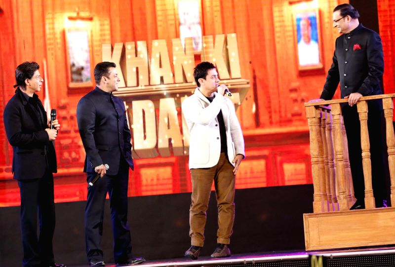 Actors Salman Khan, Aamir Khan and Shahrukh Khan with Rajat Sharma, Chairman and Editor in Chief of India TV during Aap Ki Adalat's 21st anniversary celebrations in New Delhi on Dec 2, 2014. - Salman Khan, Aamir Khan, Shahrukh Khan and Rajat Sharma