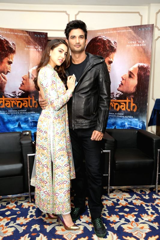 """Actors Sara Ali Khan and Sushant Singh Rajput during the promotion of their upcoming film """"Kedarnath"""" in New Delhi on Dec 6, 2018. - Sara Ali Khan and Sushant Singh Rajput"""