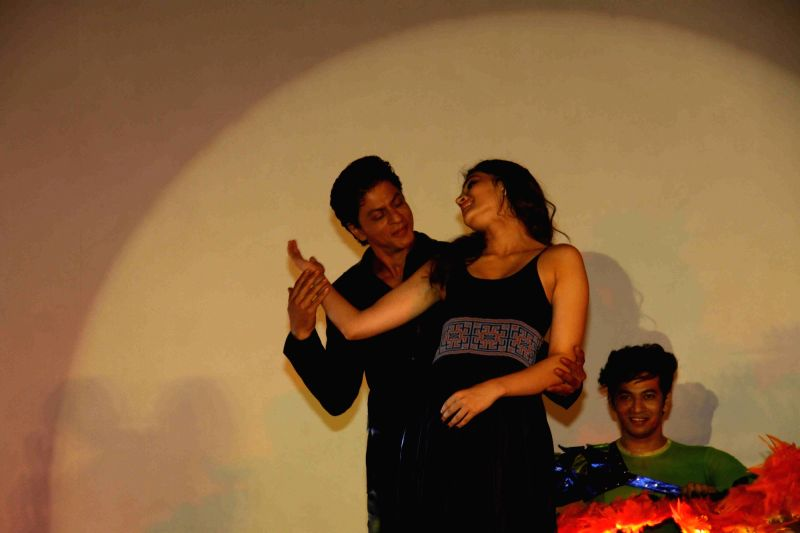 Actors Shah Rukh Khan and Kriti Sanon during the song launch of film Dilwale in Mumbai on Nov 18, 2015. - Shah Rukh Khan and Kriti Sanon