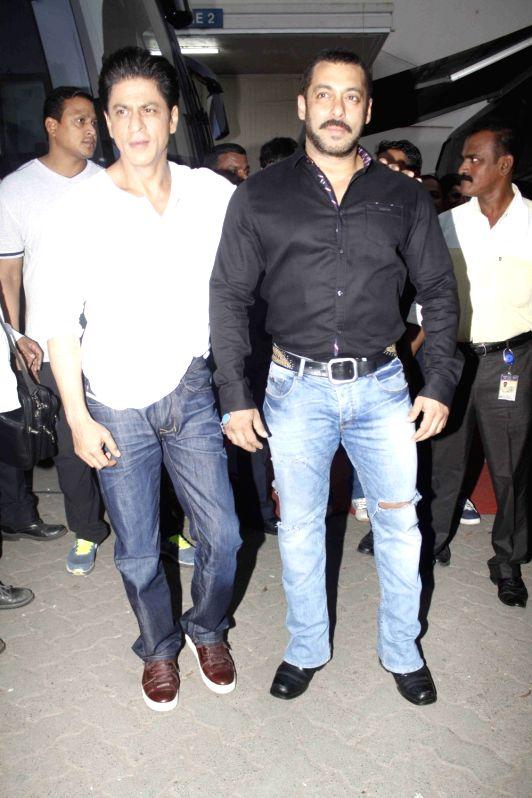 Actors Shahrukh Khan and Salman Khan at Mehboob Studio during the promo shoot of Bigg Boss season 9 in Mumbai on Dec. 8, 2015. - Shahrukh Khan and Salman Khan
