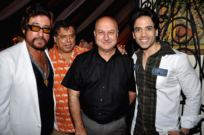 Actors Shakti Kapoor, Anupam Kher and Tushar Kapoor with filmmaker David Dhawan during a success party hosted by Sanjay Gupta to celebrate the success of writer Milap Zaveri's films 'Main Tera Hero', - Shakti Kapoor, Anupam Kher, Tushar Kapoor and Sanjay Gupta