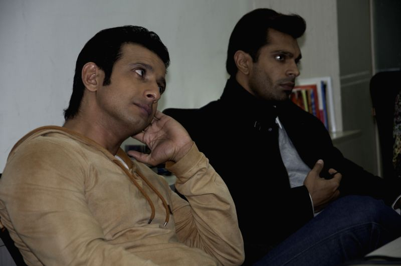 Actors Sharman Joshi and Karan Singh Grover during their visit to IANS office in New Delhi, on Dec 2, 2015. - Sharman Joshi and Karan Singh Grover