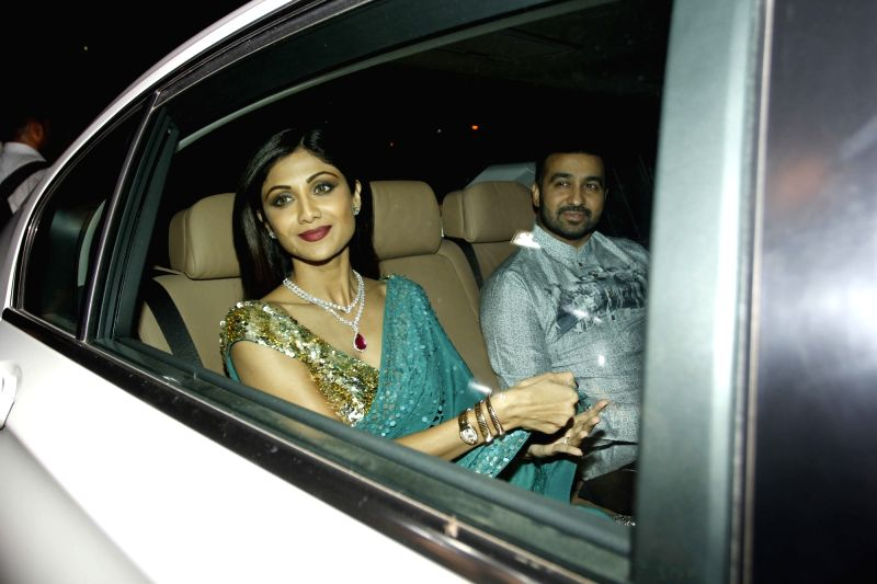 Actors Shilpa Shetty with her husband Raj Kundra arrive to attend the Amitabh Bachchan's Diwali party in Mumbai on Nov 11, 2015. - Shilpa Shetty and Raj Kundra